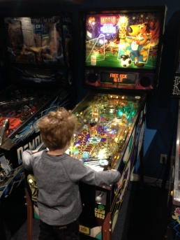 The boy playing his new favourite game.  Made the trade worthwhile.